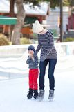 Family ice skating Royalty Free Stock Photos