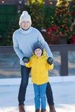 Family ice skating Stock Photo