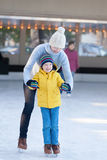 Family ice skating Stock Image