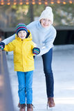 Family ice skating Royalty Free Stock Image
