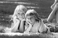 Family idyll. Mother and son on lawn of  monochrome image Stock Photography