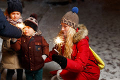 Family ignited sparklers in Christmas Royalty Free Stock Photos