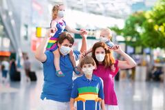 Free Family In Airport In Face Mask. Virus Outbreak Stock Photos - 176795993