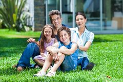 Family In Big House Stock Photo