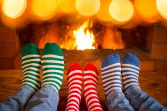 Free Family In Christmas Socks Near Fireplace Royalty Free Stock Image - 103190606