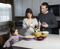 Family In Kitchen. Stock Photos