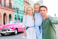 Free Family In Popular Area In Old Havana, Cuba. Portrait Of Two Kids And Young Dad Outdoors On A Street Of Havana Stock Photography - 132825722