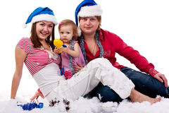 Family In Santa S Hat Sitting In Artificial Snow Stock Photography
