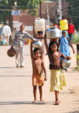 Family in India, which must carry water to house Stock Photos