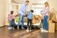 Family indoors, relocation. Stock Photos