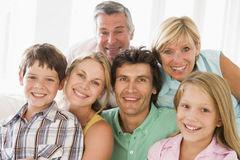 family indoors smiling together