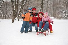 Family inforest at winter Royalty Free Stock Photo