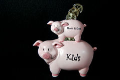 pink piggy banks stack on black with coins Stock Photos