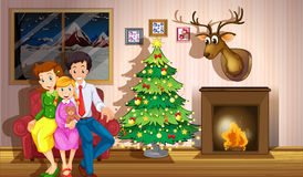 A family inside the room with a christmas tree Stock Photo