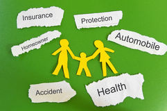 Family insurance. Paper family and insurance themed paper pieces Stock Images