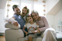 Family and iPod. Young family at home. Family using together iPod.  Young family at home. Close up Stock Images