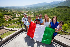 Family with Italian flag. Green valley. Pride Royalty Free Stock Image