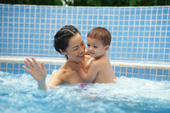 Family in jacuzzi Royalty Free Stock Images