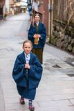 Family in Japan. Family of mother and daughter wearing yukata traditional Japanese kimono at street of onsen resort town in Japan Stock Image