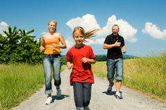 Family jogging stock images