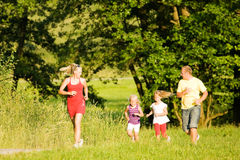 Family Jogging. Family  jogging with two little daughters Royalty Free Stock Image