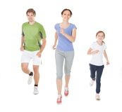 Family jogging against white background Royalty Free Stock Photo
