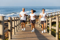 Family jogging beach Royalty Free Stock Image