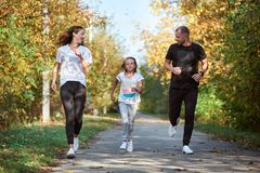 Free Family Jogging In The Park Stock Photos - 167880503