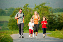 Family jogging outdoors royalty free stock photography