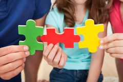 Family joining puzzle pieces Stock Image