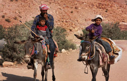 Family in Jordan, Middle East. A family in Petra, Jordan, riding donkeys stock photography