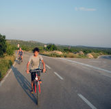 Family journey by bicycles. Bicycle tour in the summer in Croatia Stock Photo