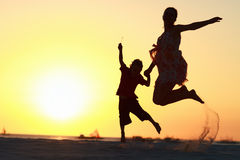 Family jumping Stock Photos