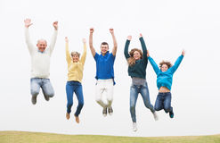 Family jumping on the air at park Royalty Free Stock Photos