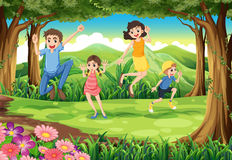A family jumping in the forest Stock Photo