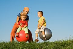 Family jumping on grass royalty free stock photo