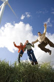 Family jumping in grass Royalty Free Stock Images