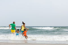 Family jumping in the sea stock image