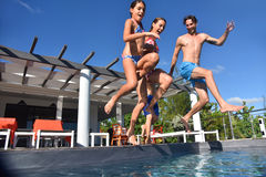 Family jumping to swimming pool together Royalty Free Stock Photos