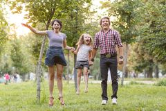 Family jumping Stock Images