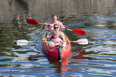 Family in Kayak at river Ourthe near La Roche-en-Ardenne, Belgium Royalty Free Stock Photography