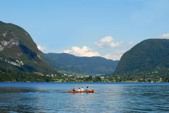 Family kayaking on bohinj lake Stock Photos