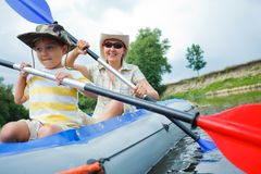 Family kayaking Stock Photos