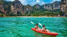 Family kayaking, mother and daughter paddling in kayak on tropical sea canoe tour near islands, having fun, vacation in Thailand royalty free stock images