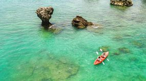 Family kayaking, mother and daughter paddling in kayak on tropical sea canoe tour near islands, having fun, active vacation royalty free stock photos