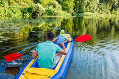 Family kayaking on the river Stock Photos