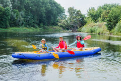 Family kayaking on the river Royalty Free Stock Photos