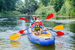 Family kayaking on the river Stock Photography