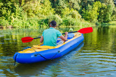 Family kayaking on the river Stock Images
