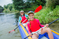 Family kayaking on the river Royalty Free Stock Images
